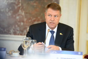 Iohannis says Romania should do more on defense