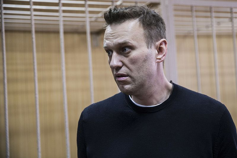 Putin critic Navalny detained by police before pre-election rally