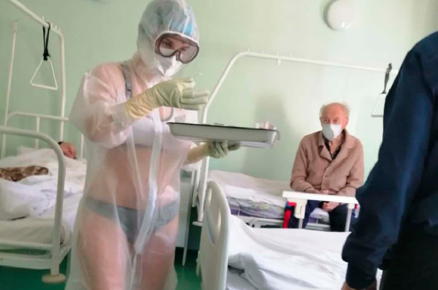 Only In Russia: 'Hot' Nurse Disciplined For Wearing Bra And Panties Under See-Through PPE Gown