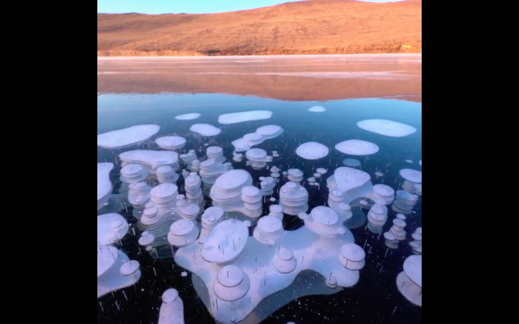 Beauty Of Frozen Methane Bubbles On The World's Deepest Lake Shown In Stunning Video
